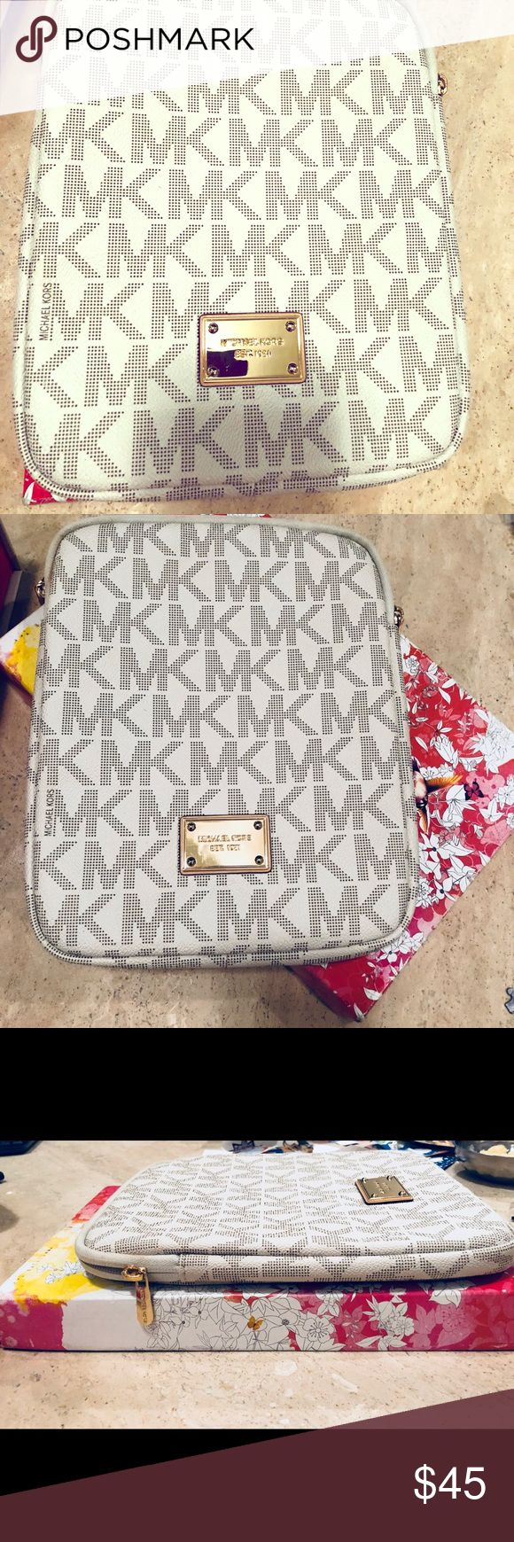 Authentic Michael Kors Tablet Case MK Used only a couple of times. Purchased in Dubai mall a couple of years ago. Under the case is a standard shoe box lid which will give you an idea of the size. Michael Kors Accessories Laptop Cases