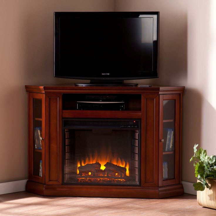 For The Entertainment Enthusiasts, This Mahogany Glazed Fireplace  Accommodates Wonderfully. Triangular Media Storage Shelves Enclosed By  Glass Doors On ...