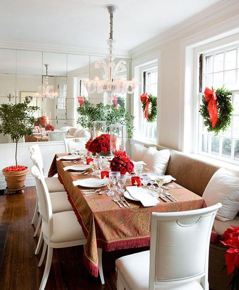 Mirror wall beside a wall of windows. Christmas dining table decor