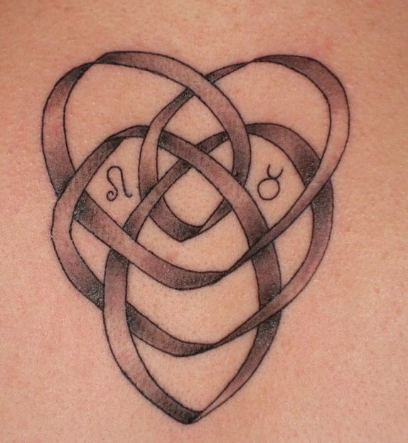 My (Amphitryte) first tattoo, June 2010. Celtic knot of motherhood holding my kids' zodiac signs: my Leo son and Taurus daughter <3