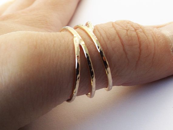 Gorgeously textured wrap around 14k yellow goldfill hammered ring. Simple, sleek and elegant in design, the highly polished finish catches the