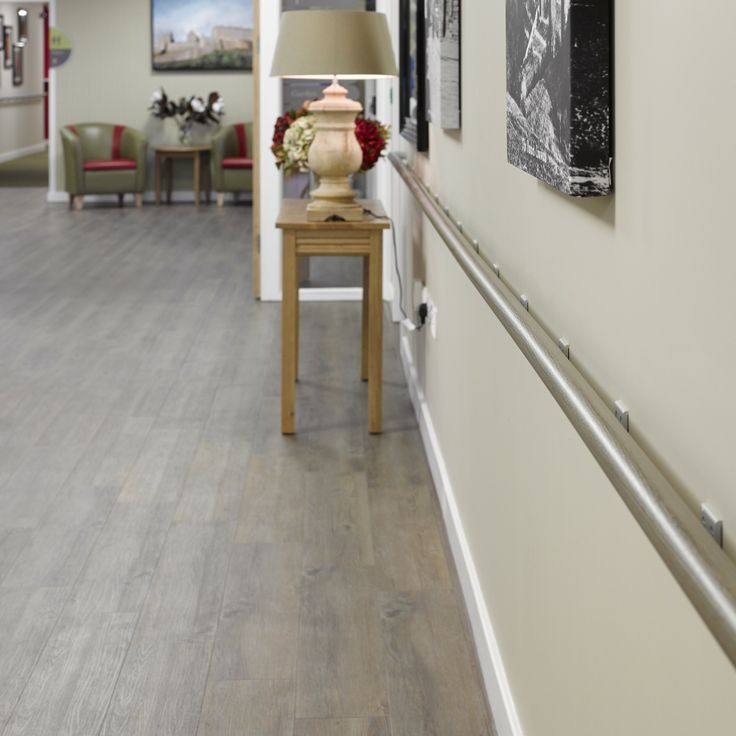 Gerflor Clic System flooring and Escort Decowood timber effect handrails at new extra care housing development.