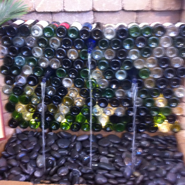 Wine bottle fountain craft worth doing pinterest for Outdoor decorating with wine bottles