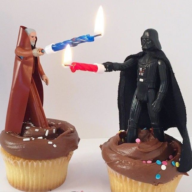 Turn Star Wars action figures into cake toppers + use candles as light sabers.