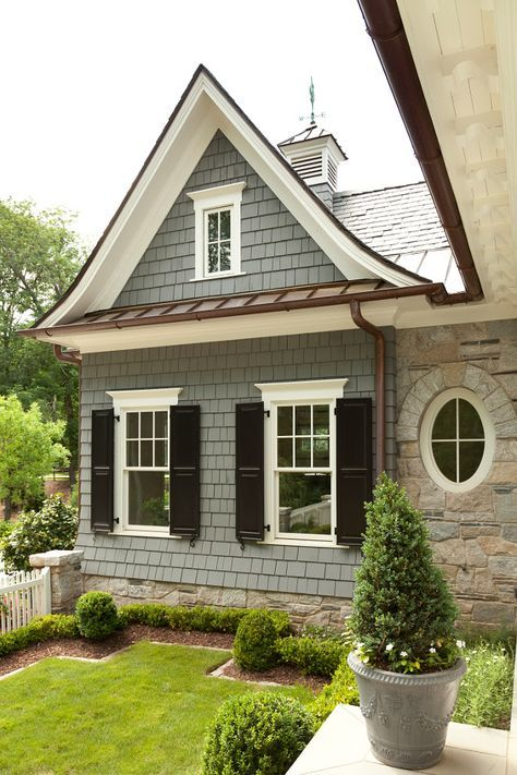 Cedar shingle siding, bronze and copper, white and black windows, round windows, house exterior
