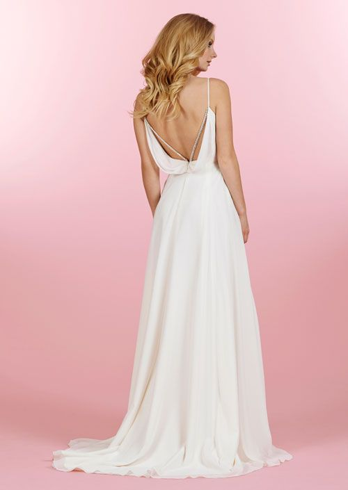 Ivory chiffon soft A-line bridal gown with crossover draped bodice, beaded peekaboo neckline and low back cowl accented with crisscross crystal strapping available at Sophia's Bridal Tux and Prom in Indianapolis.