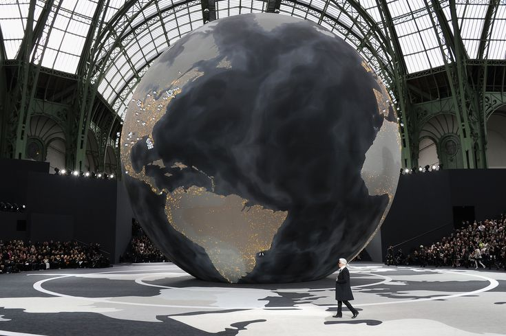 "Chanel 2013. According to Elle UK, the globe was stamped with flags, marking Chanel store locations. ""It's about the globalization of fashion,"""