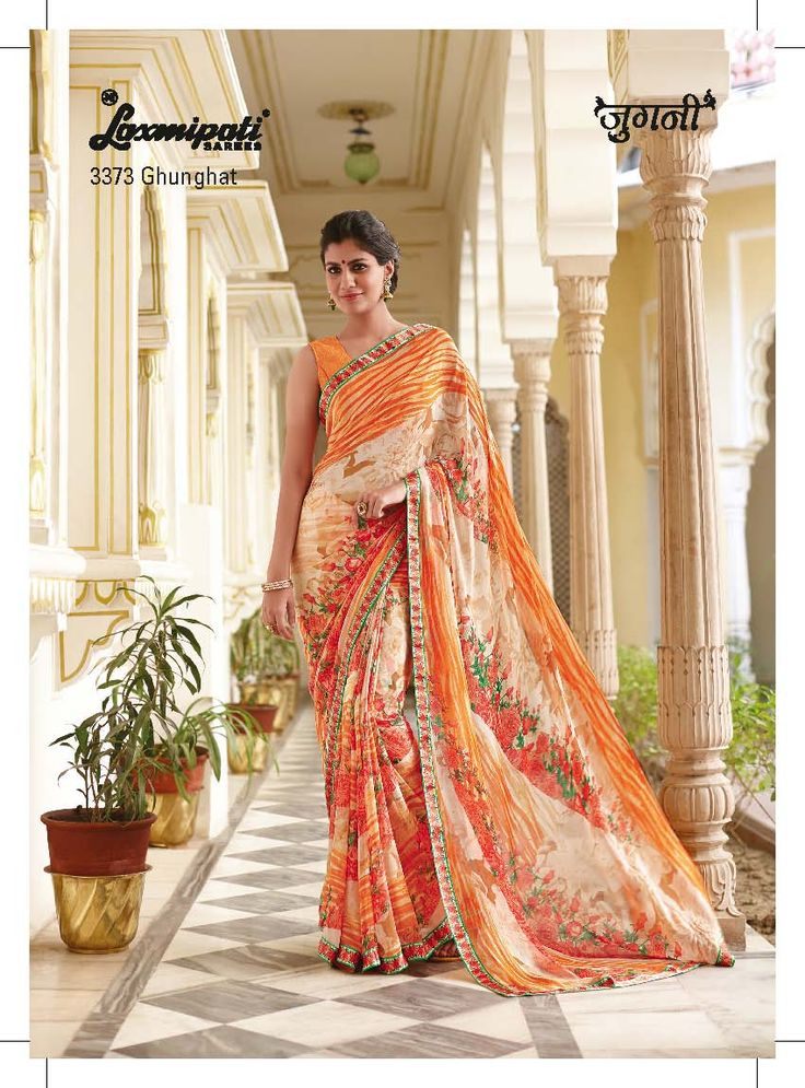 This stylish saree features floral and wavy prints on the shades of orange & off white.