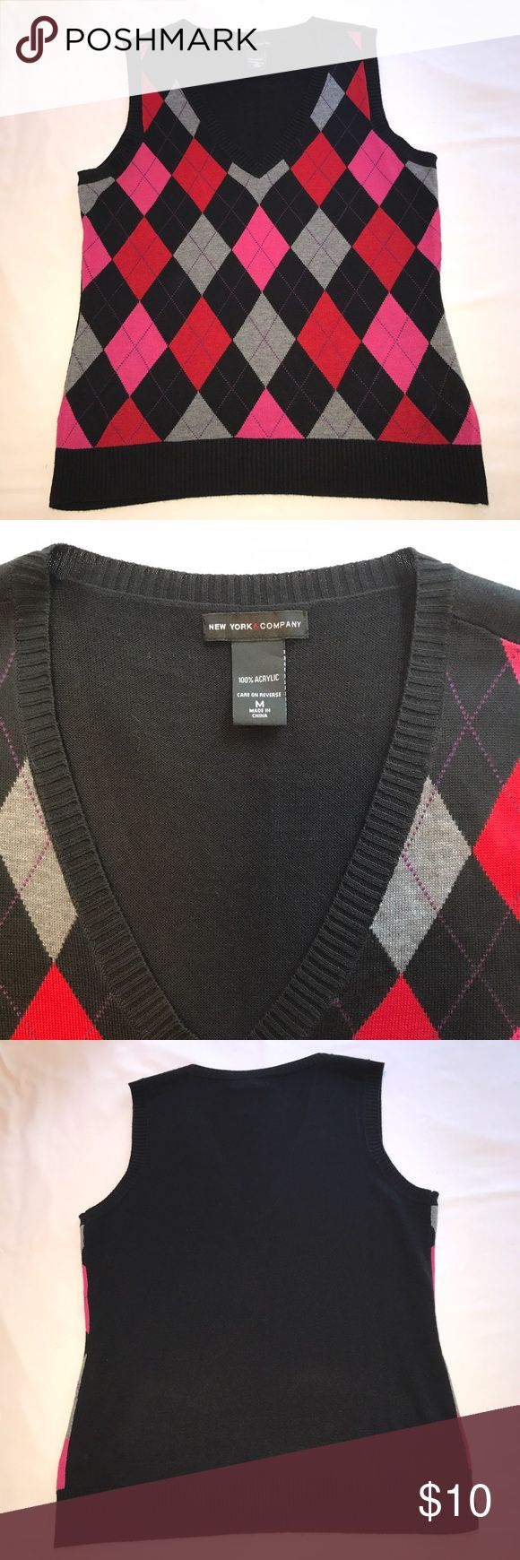 """Argyle NY & Co Sweater Vest Cute and comfy argyle sweater vest.   Pink, red, black, and gray diamonds with thin purple lines throughout.   Black back.  V-neck, excellent condition, 100% acrylic.  Armpit to armpit 18"""", length 24"""" flat. Made by New York & Company.   Size Medium New York & Company Tops"""