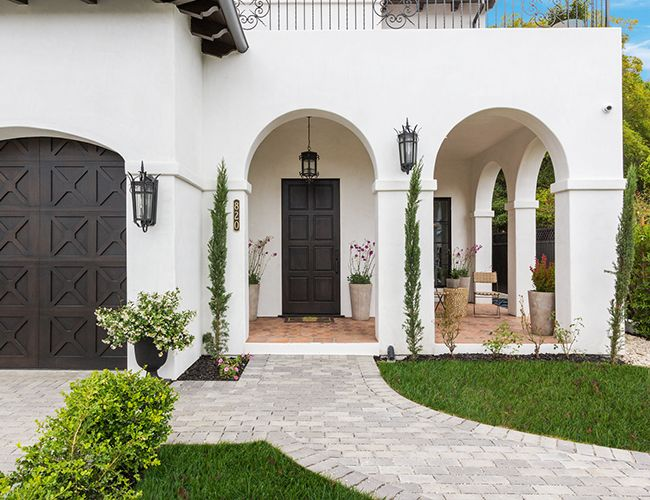 Tour This Stunning Modern Spanish Home In L A Inspired By This Spanish Style Homes Spanish Revival Home Mediterranean Homes Exterior