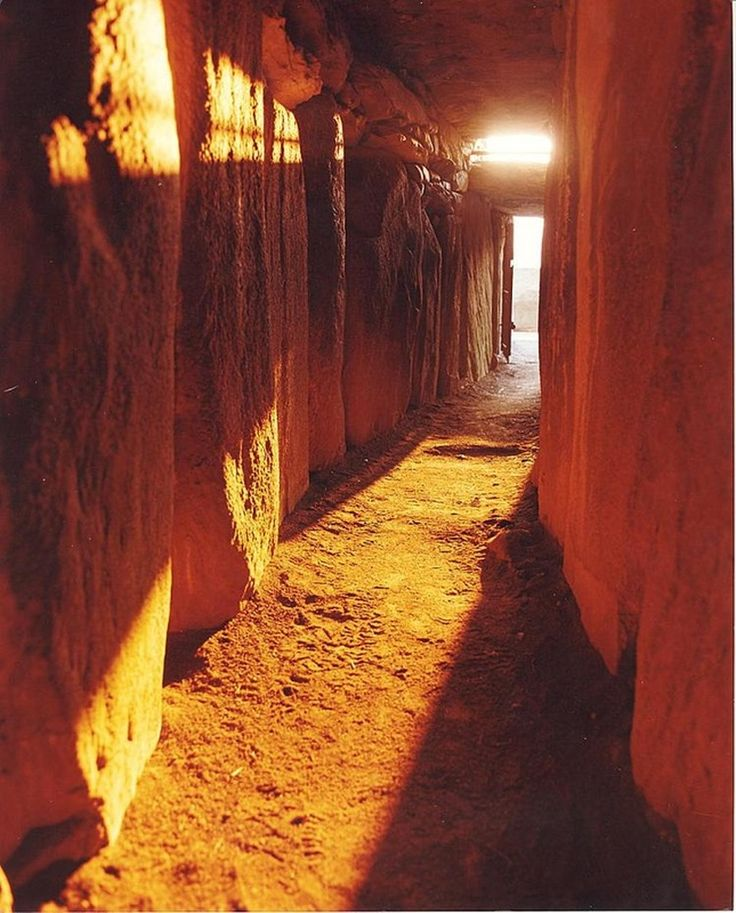 "Newgrange, Ireland. The sun entering the passageway Winter Solstice. ""There is no agreement about what the site was used for, but it has been speculated that it had religious significance – it is aligned with the rising sun and its light floods the chamber on the Winter Solstice."""