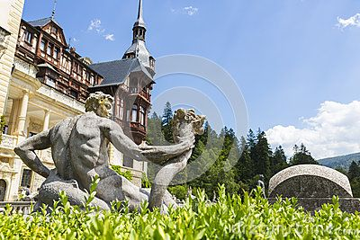 Antique allegoric statue detail in Peles castle garden, Sinaia, Romania. Peles castle is the most visited museum in Romania with more than 300.000 tourists every year.