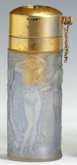 France, A Rene Lalique atomizer [clear perfume bottle with figures], raised block letters: R. Lalique, Made in France.