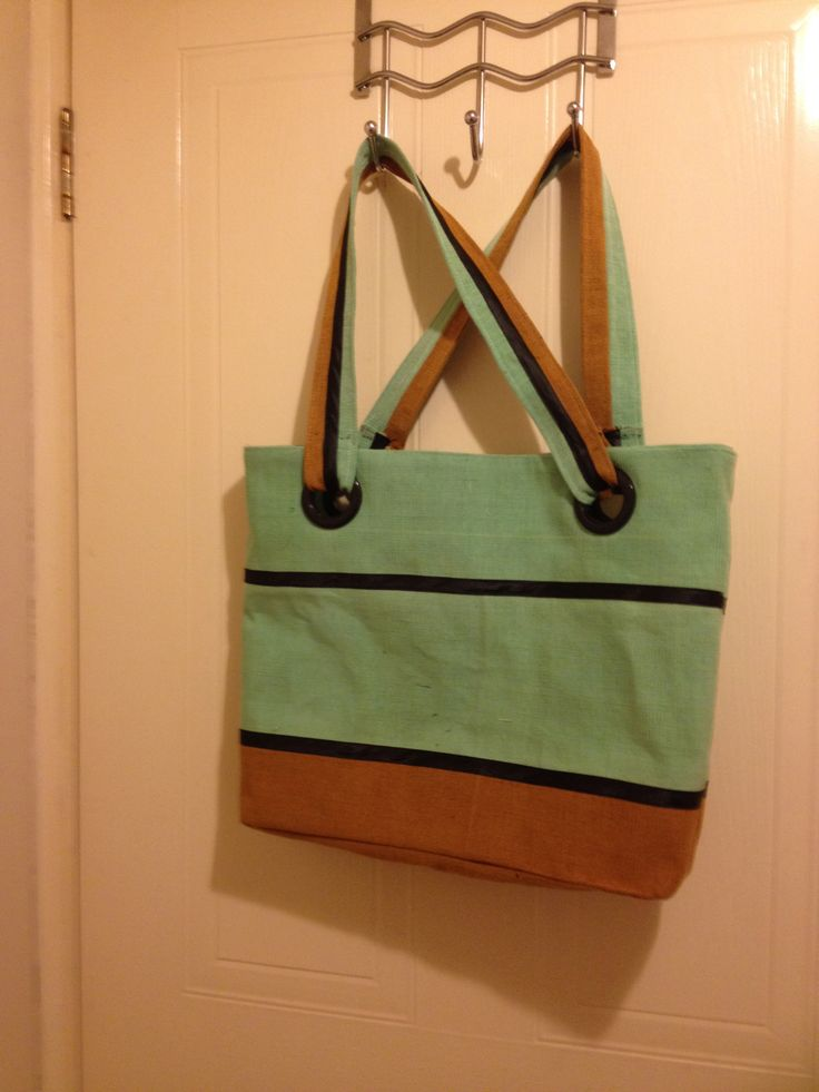 Lined and zippered tote bag I made from strips of Nigerian Aso-Oke bound with bias and with curtain eyelets for attaching the handles