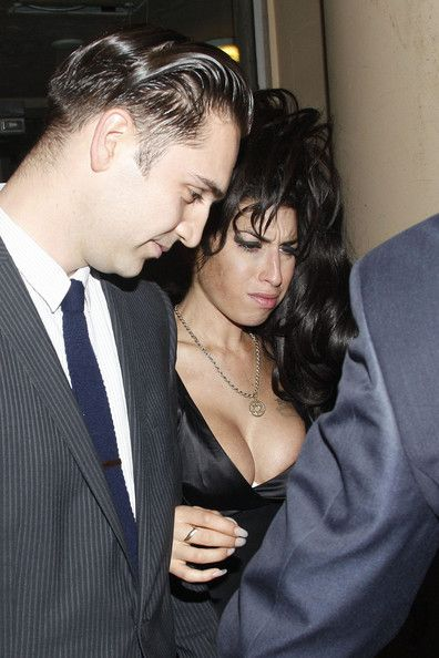 Amy Winehouse Photos Photos - Amy Winehouse and boyfriend Reg Traviss attend a South African-themed restaurant bar called Shaka Zulu which recently opened in Camden which was hosted by King Goodwill Zwelithini of South Africa. Amy looked a little wobbly on her feet and she was struggling to keep her eyes open as Reg guided her in. On the way out of the party Amy had trouble getting into the car and need a bit of help from Reg as he lifter her up and into the back seat of the car. - Amy…