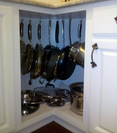 DIY Pot Rack - Would be great, but only feasible if you don't have drawers directly above...