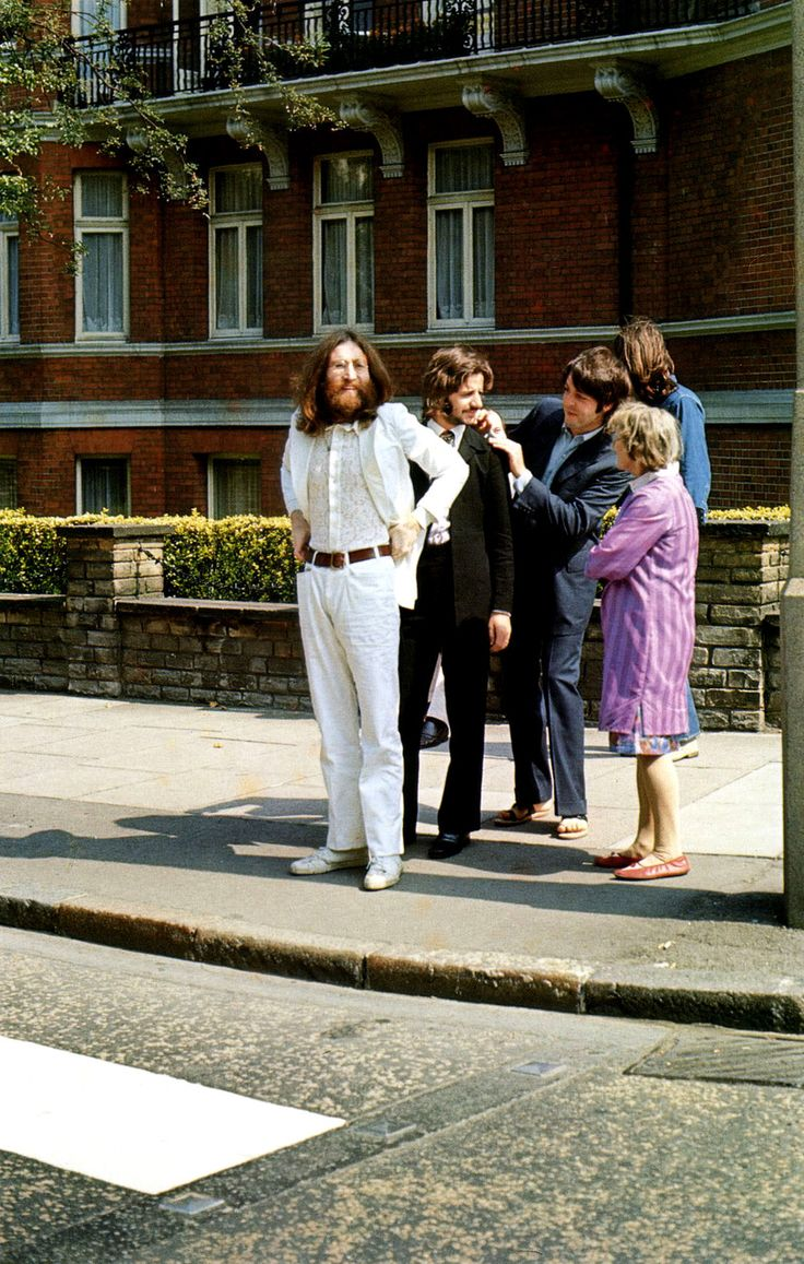 The Beatles try to get their helping an old lady across the road badge