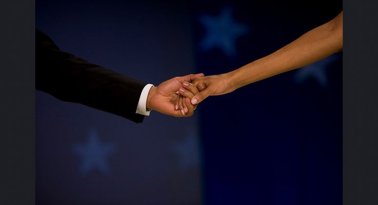 Obama and first lady Michelle Obama hold hands at the Biden Home State Inaugural Ball in Washington, on Jan. 20, 2009.