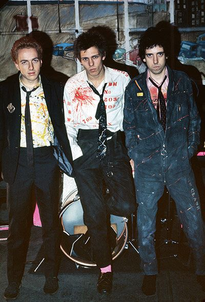 The Clash in their rehearsal studio, London, 1976 I met them at their ICA gig in 1976 and went to Chalk Farm to photograph them soon afterwards. They look cool and lean and hungry. They had iconic status even then. The look is down to Paul Simonon [centre]. He did the clothes, the backdrops, the Jackson Pollock splashes on the shirts. Mick [Jones, right] and Joe [Strummer, left] wrote the songs, but Paul was the artist.