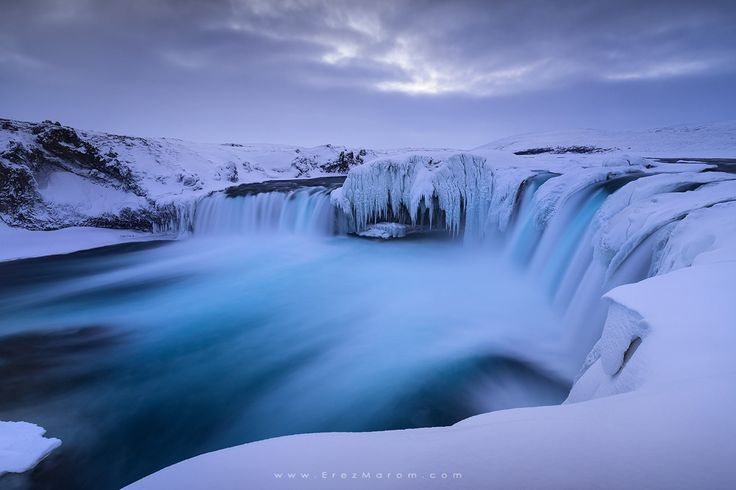 """The Icy Flow of Goðafoss - A frigid morning in Goðafoss. The cloud cover above and icy cover below seemed very fitting for this spectacular waterfall. This image was taken on my '<a href=""""http://www.erezmarom.com/index.php/photography-workshops/view/winter-paradise-north-iceland-winter-photo-workshop"""">Winter Paradise</a>' southern Iceland workshop this January. If you'd like to experience and shoot some of the world's most spectacular destinations, check out next year's <a…"""