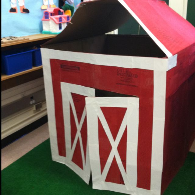 Our farm theme dramatic play barn! Built with moving boxes, painted by the kids, and made for fun!