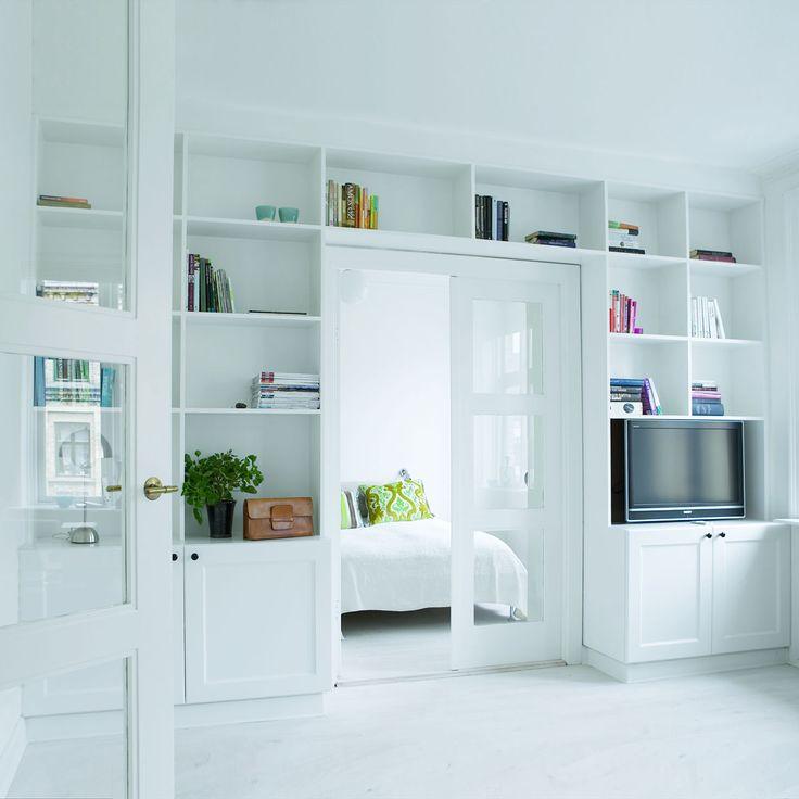sliding door idea. Small apartment bedroom/living room transition