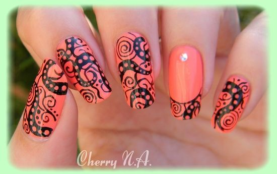 Black design over coral base by Cherry Nail Art