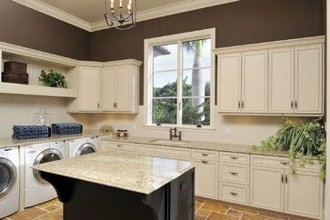 Large Laundry Room with Island by Olde World Cabinetry