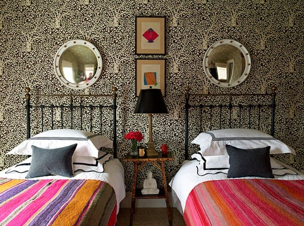 twin beds, wallpaper, convex mirrors, black lampshade, striped coverlets, white linens, gray pillows, antique bedside table