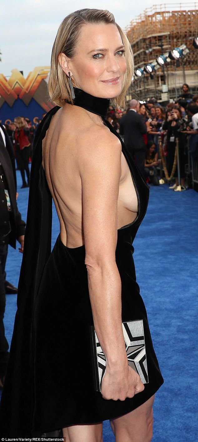 Revealing: Robin Wright flashed plenty of sideboob in a backless and sleeveless black dress with a halter neck and long sash at the world premiere of Wonder Woman in LA Thursday