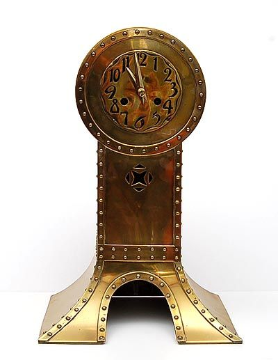 Brass clock with clinch-bolts as decorative elements execution attributed to Onder den St.Maarten Zaltbommel / the Netherlands ca.1905