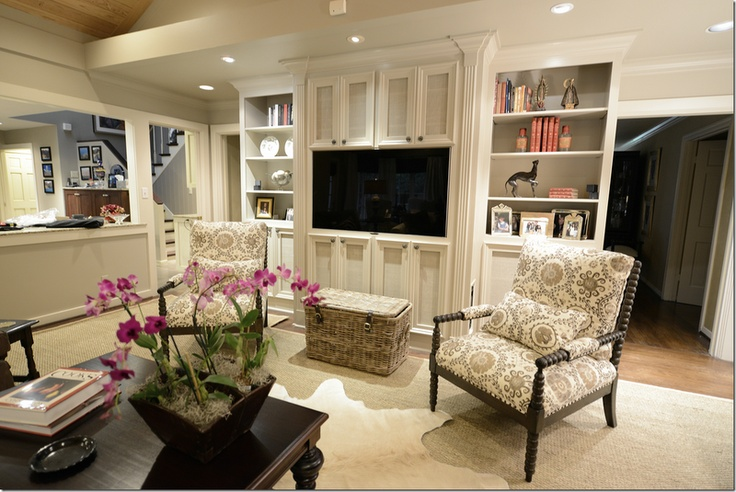 Joni Webb/Cote de Texas Living room built in...equipment and speakers behind cabinet doors with screening to allow for audio
