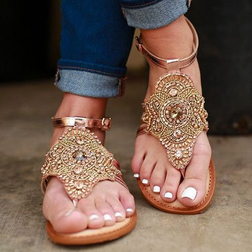 Pretty White Toes in Fancy Sandals