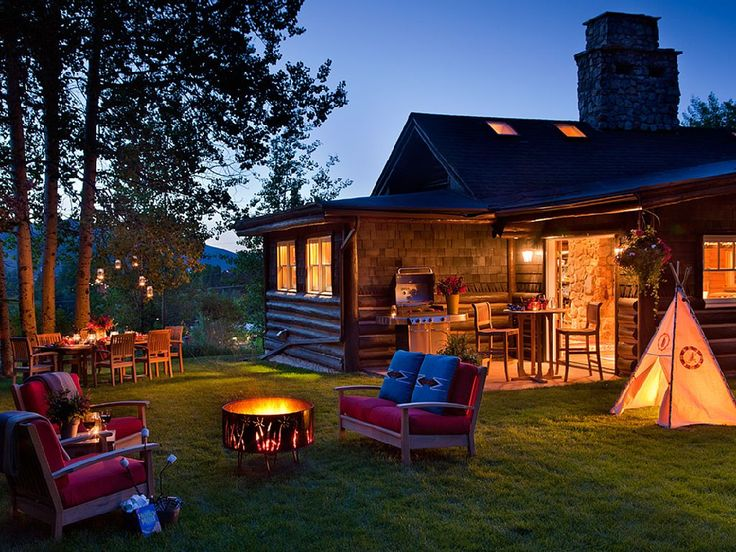 This picturesque cabin in Jackson Hole is stunning! With three bedrooms, bunk beds, an awesome outdoor area and a tepee...what's not to love?