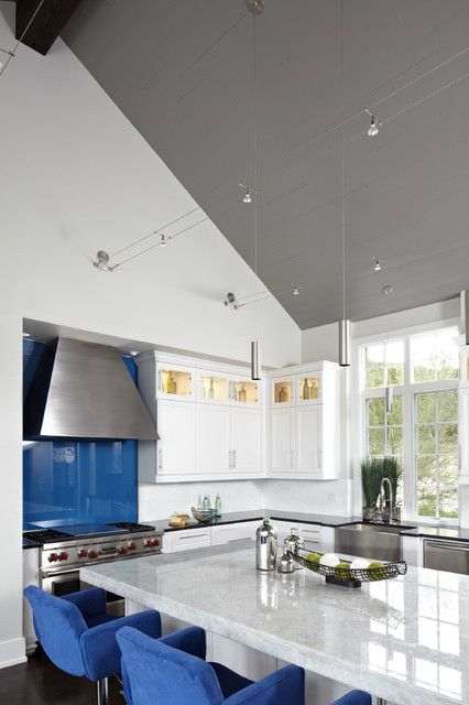 Best 25 pendant track lighting ideas on pinterest track cool white and blue themed kitchen idea brightened by pendant track lighting attached above white vaulted ceiling aloadofball Gallery