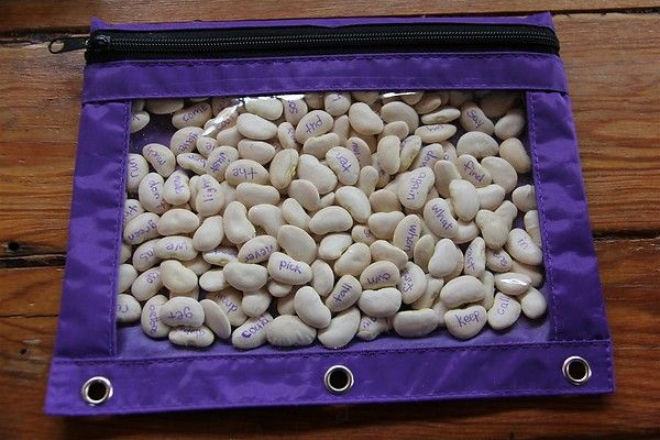 sight words written on beans inside a pencil bag. Shake and read the words that pop up
