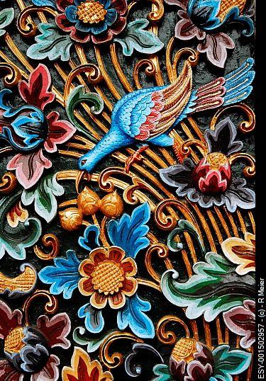 Colorful wood carvings 1922 Bali Floating Leaf Eco-Retreat. http://balifloatingleaf.com/