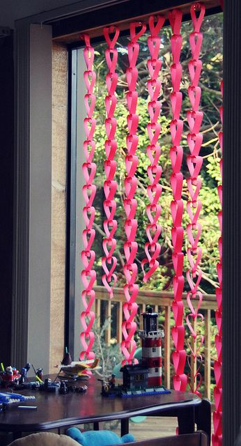 paper heart chains in window for valentines day