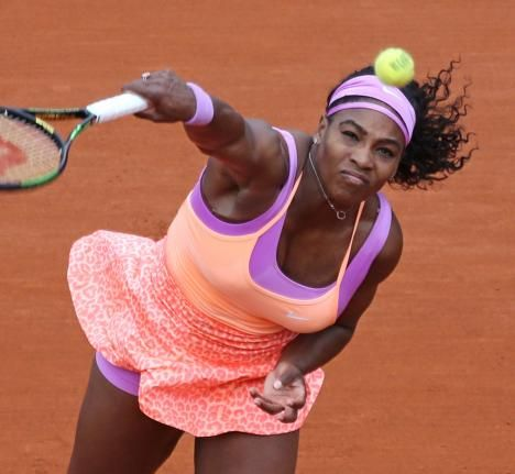 American Serena Williams hits a serve during her French Open women's second round match against Anna-Lena Friedsam of Germany at Roland Garros in Paris on May 28, 2015. Williams defeated Friedsam 5-7, 6-3, 6-3 to advance to the next round. Photo by David Silpa/UPI