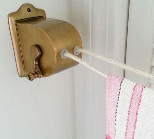 This traditional clothesline features a quaint hand crank to reel in the line. Vintage-Style Brass Retractable Clothesline Dryer, about $35; Farmhouse Wares.