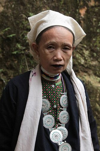 Dao Tien tribal woman (Market at the Ba Be lake). The Dao (pronounced Zao) are the 9th largest ethnic group in Vietnam with a population of just under 500,000. They belong to the Hmong Dao language group and are believed to have started migrating from China in the 13th century. The women wear some of the most colourful and diverse costumes of all ethnic groups but can be identified by their black trousers richly embroidered with flower or small star patterns. Their jackets can be red or…