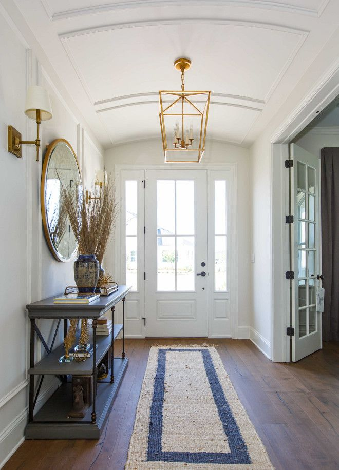 Light fixture, mirror and console table are from Restoration Hardware.