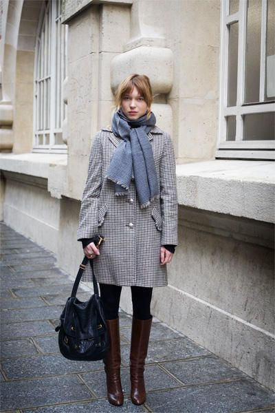 Lea Seydoux. tall boots. long coat. pale colors.