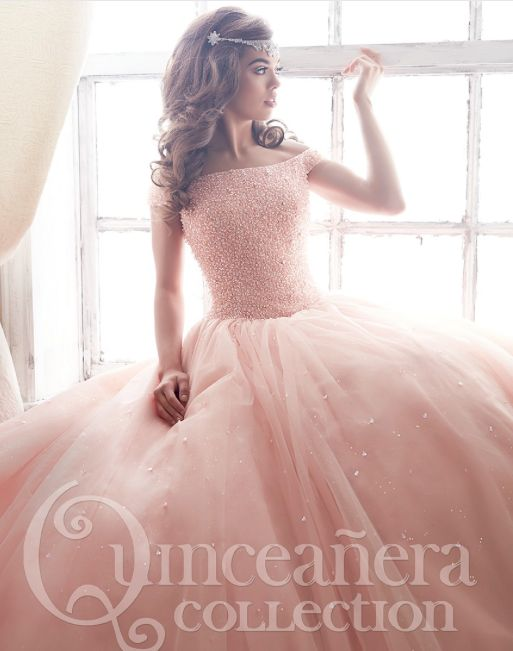 We fell in love with this pink off-the-shoulder dress while browsing through their catalogue. It's elegant, timeless, and everything you expect from a quinceanera dress. The simplicity of the design makes it easy to go all out in other categories, such as hair & makeup. - See more at: http://www.quinceanera.com/dresses/20-new-off-the-shoulder-quinceanera-dresses/#sthash.yS58YSDE.dpuf