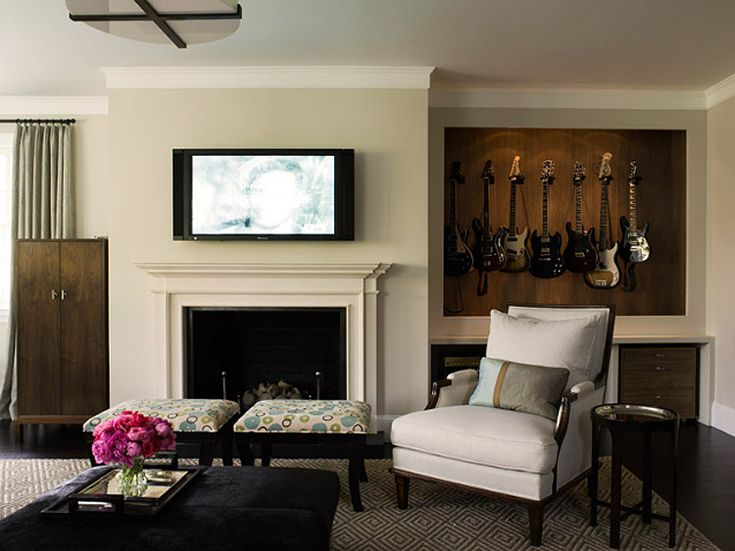 almost missed this jem.... recessed hanging storage for guitars in lieu of built in shelves. Added lighting makes the guitars look like art.