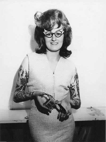 back in her day it was hard to have lots of tattoos this woman is made of tough stuff!!!