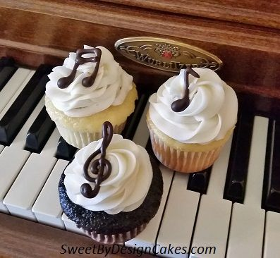These chocolate and vanilla cupcakes were topped in our vanilla buttercream and hand piped chocolate music notes and treble clefs for a piano recital reception.