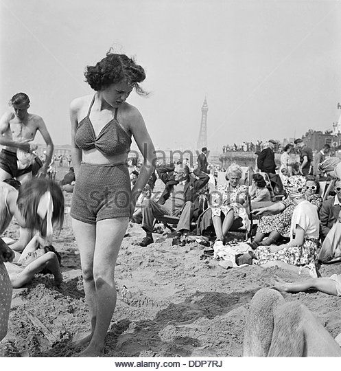 A young woman in a knitted bathing costume on the beach, Blackpool, c1946-1955. Artist: John Gay - Stock Image
