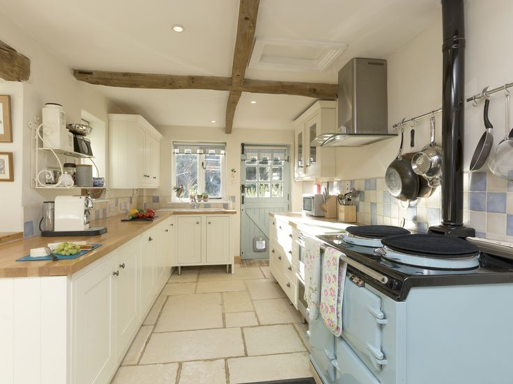 Boasting Plenty Of Character Is This Well Equipped Kitchen With Beams And  Aga.