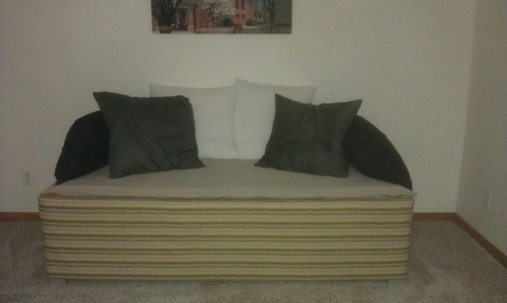 Homemade couch using box springs, fabric, and mattress pad